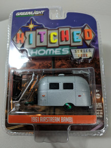 1:64 Hitched Homes Series 4 - Airstream 16' Bambi with Red and White Awning Green Machine