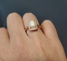 14k Gold emerald cut solid gold with a brilliant halo of diamonds 9x7
