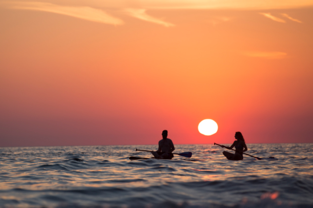 sunset paddle board celebration