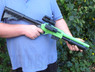 Guy with Double Eagle M47D2 Pump Action Shotgun in green