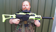 Guy with Double Eagle M85 Electric Rifle in Radioactive green
