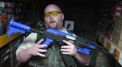 Guy with  Cyma CM028C AK47  in blue