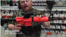 Guy with Well D2804 Electric Airsoft gun in orange