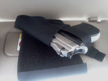 Place your firearm above your driver or passenger's sun visor. If your firearm fits above your vehicles visor then this holster will work for you.