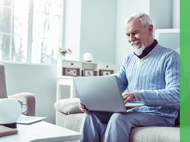 Senior man looking at CPAP machine options online.
