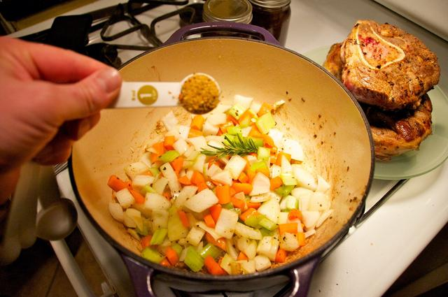 chopped vegetables coated with olive oil and italiano pronto in dutch oven