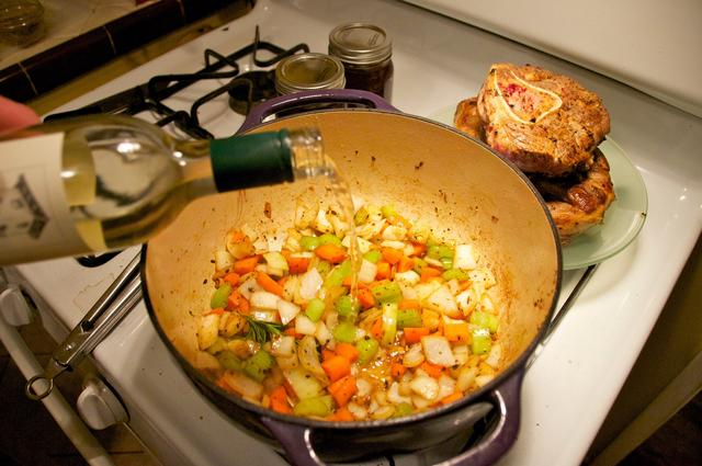 white wine added to chopped vegetables in dutch oven