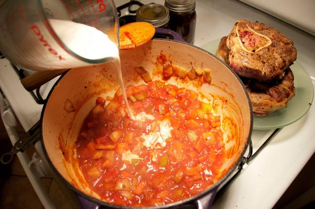half and half added to chopped vegetables with white wine and tomato paste in dutch oven