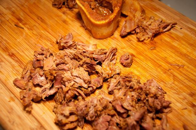 shred or cut beef shanks on cutting board