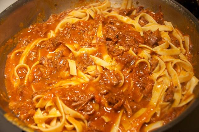braised beef shank meat sauce and pasta mixed together