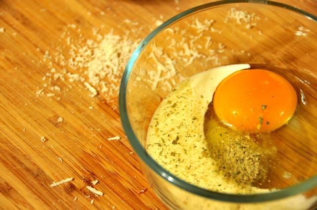egg milk french seasonings in a mixing bowl