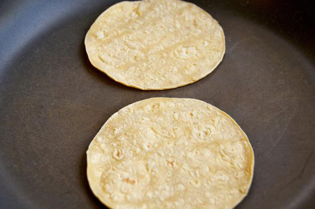 corn tortillas on a hot pan