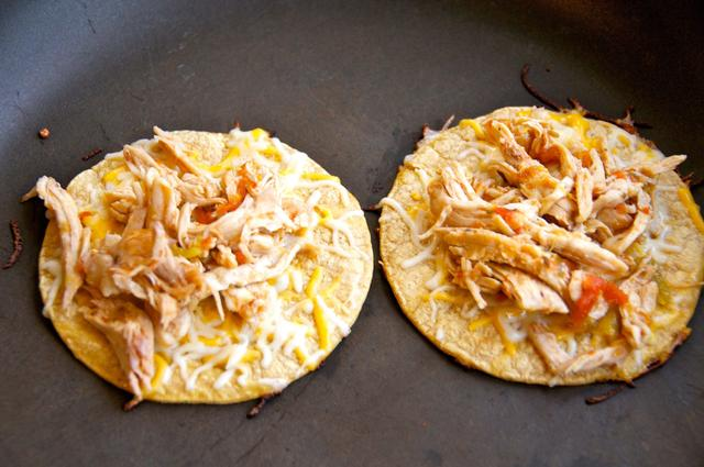 corn tortillas with cheese and shredded chicken