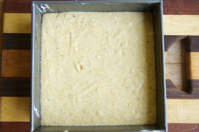 cornbread batter in a square baking pan