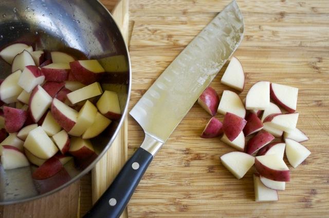 cut red potatoes on cutting board
