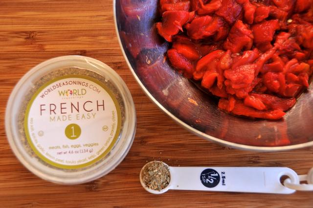 add french seasonings to chopped red bell peppers
