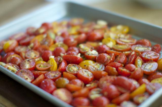 seasoned cherry tomatoes on baking sheet