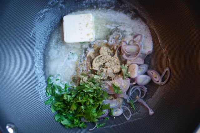 shallots and parsley coated with butter and french made easy seasonings in a cooking pot