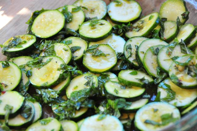 sliced zucchini mint oregano coated with olive oil