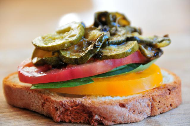 stack bread with sliced tomato basil leaf roasted zucchini