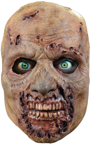 Straight from the screen of AMC's The Walking Dead comes the Rotted Walker Face Mask. The Rotted Walker is a highly detailed face mask that includes a rotting jaw, exposed teeth and rotting nose that is shared by all Walkers in AMC's number one hit show, The Walking Dead. John Wrightson, the artist that sculpted a number of The Walking Dead Walkers for Universal Studios Halloween Horror Nights - The Walking Dead Maze, used hundreds of screen references to ensure that the Rotted Walker Face Mask looks like it came right off the screen of The Walking Dead. So get yourself the Officially Licensed The Walking Dead Rotted Walker Face Mask, our Walker Chest, and some torn up clothes and go out and stalk the living this Halloween!!