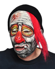 Scared of clowns? You will be with this hideous mask! Mask has half-smoked cigarette, painted face of a drunk clown. Latex over the face mask with toboggan and hair attached.