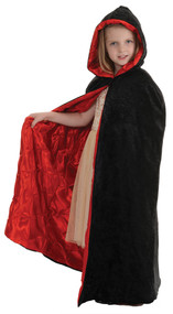 Your little witch or vampire will look great in this cape! Black velvet cape with red pin-tuck lining. One size fits most.