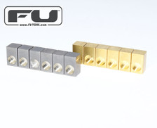"""<p><span style=""""color: #ff0000;"""">**NEW**</span>From FU-Tone.com:</p> <p>NAVAL BRASS set of 6 Saddle Inserts, for the ultimate in TONE and Functionality! Stock steel saddles constantly fail by cracking, expanding (and getting stuck!), corroding and just don't sound good...</p> <p>Naval Brass has all of tonal qualities of brass which increases sustain, clarity, definition and warmth. Naval Brass will not expand or crack in your saddle. FU-Tone continues to bring you to new heights in chasing YOUR ultimate tone!</p> <ul id=""""productDetailsList"""" class=""""floatingBox back""""> <li>Model: NBSLB006</li> <li>Manufactured by: FU-TONE.com</li> </ul>"""