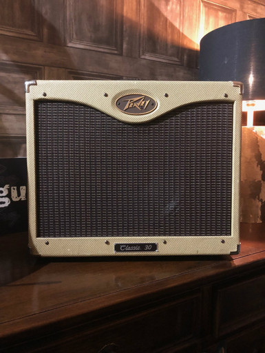 Preowned Peavey Classic 30 made in USA. Fantastic condition with no marks on the tweed covering that we can spot. Just revalved and serviced and sounds great!