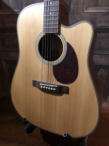 "Preowned in excellent condition with only a few small indentations on the top and on the very tip of the headstock. As with all used instruments the pictures provided form part of the description so please study them carefully.  This Freshman Songwriter Acoustic Guitar really does blow the phrase ""you get what you pay for"" out of the water. With features and materials rarely seen on a guitar at this price along with superb craftsmanship, you really will be pleasantly surprised by the great tone and feel of this excellent guitar. Oh, and if the incredible spec wasn't enough - it comes with a lifetime warranty!  Be Creative. Whatever Your Stage.  Review  ""Displays a proud and timeless dreadnought tone right from the off... What makes this Freshman stand out from the crowd is the fact that solid construction makes this guitar one to savour over the years..."" - Acoustic Magazine, 4 out of 5 'Excellent'  Tone and Sound  What does it sound like? The SONGDCE rewards passionate playing, with lively tones harmoniously jumping off its soundboard. Its sleek cutaway opens up your options, freeing you to explore. The dreadnought body shape has long been held in high regard for its strength of character, but in the SONGDCE you will find an intriguing personality that welcomes you to push beyond your comfort zone. The SONGDCE marries the best of tradition with a modern heart, asking questions of the songwriter. The answers will never disappoint.  The SONGDCE is fitted with a premium AER Tube System. These outstanding electronics are exclusive to Freshman Guitars, developed and specifically voiced in conjunction with the world-leading German acoustic electronics company. The marriage of the two has resulted in a system that produces a true replication of the acoustic tone, unlike any other, and at an unbelievable price.  Build and Finish  Using a higher grade of tonewood than you would ever expect to find in this price bracket, the all solid SONGDCE features a beautiful 'AA' Grade Sitka Spruce top, and select Mahogany back and sides, all subtly bound with Mahogany and finished with Herringbone purfling. These higher grade woods will age perfectly, rewarding you every time you play, with clean lines and flawless finish a hallmark of the series.  SONGDCE Specification  Body Type: Dreadnought Cutaway Electro-Acoustic Top: Solid Canadian 'AA' Grade Sitka Spruce Back & Sides: Solid Select Mahogany Neck: Mahogany Fingerboard: Rosewood Binding: Mahogany Purfling & Rosette: Herringbone Hardware: Gold Bespoke Machine Heads Back Centre: Herringbone Nut & Saddle: Bone Nut Width: 43mm Electronics: AER Tube System Finish: Natural Satin"