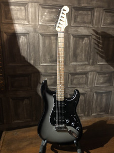 """Fender 2015 HSH Silverburst USA Stratocaster in as new condition! No scratches, dents or scrapes and looks unplayed apart from the lightest of pick swirls/polishing marks on the scratchplate. Comes with original case with all case candy/strap/lead. The only thing missing is the bar. Amazinfg guitar and not to be missed at this price...  The biggest-sounding American Deluxe Stratocaster® guitar model yet. Fender's American Deluxe Stratocaster HSH delivers even more ferocious tone, with an HSH pickup configuration featuring an N3 Noiseless™ middle pickup flanked by powerful Modern Twin Head humbucking neck and bridge pickups.   The maple neck has a """"modern C"""" profile, satin finish and Bi-Flex™ truss rod, while the fast compound-radius (9.5""""-14"""") rosewood fingerboard has 22 medium jumbo frets and an LSR roller nut. Other premium features include a comfortable contoured neck heel, five-way pickup switching, three-ply black pickguard, two-point synchronized American Deluxe tremolo bridge with pop-in arm, staggered locking tuners, locking strap buttons and four-bolt neck plate with Micro-Tilt™ adjustment mechanism. Hard-shell case included."""