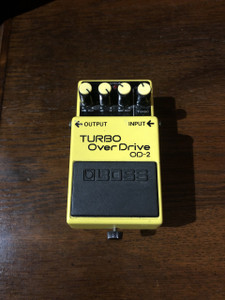 Preowned Boss OD-2 Turbo Overdrive pedal in full working order. This is the black label variant. Has velcro attached to the base of the pedal and as with all used items the pictures provided form part of the description so please study them carefully.