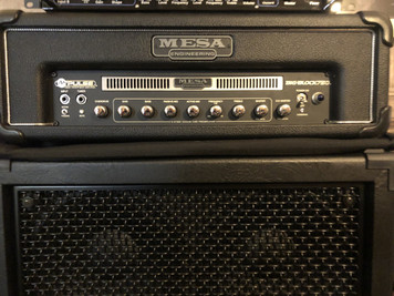Preowned but in excellent condition. Comes with original cover, manual and footswitch. Amazing USA bass amplifier!  As with all preowned items the pictures provided form part of the description so please study them carefully.  Following the unique styling of Mesa Boogie's popular M-Pulse series, the Big Block 750 bass head is capable of unleashing up to 750 watts of pure bass grit to your extension cabinet rig with all the trademark credentials that make Mesa Boogie such a revered name among seasoned Bass Guitarists. Using the overdrive and gain controls together allows you to seamlessly blend both sound elements and you can easily control the levels of the clean and distorted signals with the individual master volumes. The Big Block's exclusive Simul-State technology is powered by 4 x 12AX7 and 12 MOSFET tubes that you can run all the way up from 2, 4 or 8 ohms depending on your backline requirements. The Big Block 750 elevates today's bass performance while paying homage to that great tradition. Here is a menacing new amp that's infused with the percussion, warmth and feel of an all-tube classic while providing double or even triple the output power …and at a fraction of the weight.