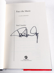 KISS Autograph - KISS Face the Music book signed by Paul Stanley, (black)