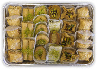 Assorted Baklava pieces beautifully arranged on a rectangular tray - Top view - Libanais Sweets