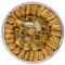 Assorted Baklava pieces arranged beautifully on a circular tray - Top view - Libanais Sweets
