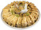 Assorted Baklava pieces arranged beautifully on a circular tray - Front view - Libanais Sweets