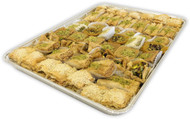 Assorted Baklava pieces arranged on a rectangular tray - Angled front view - Libanais Sweets