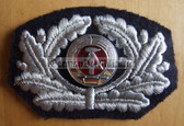 om121 - East German Firefighters Visor Hat insignia - visor cockade