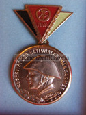 om924 - 3 - East German NVA  Reservist Medal in Bronze with Steel Helmet