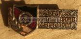 om596 - c1960s DDR Nationale Front award badge in gold - enamel