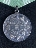 om078 - VOLKSPOLIZEI VP - long service medal in Silver without state crest in burgundy box