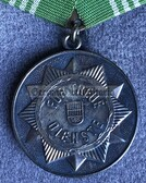 om142 - VOLKSPOLIZEI VP - long service medal in Silver without state crest in box