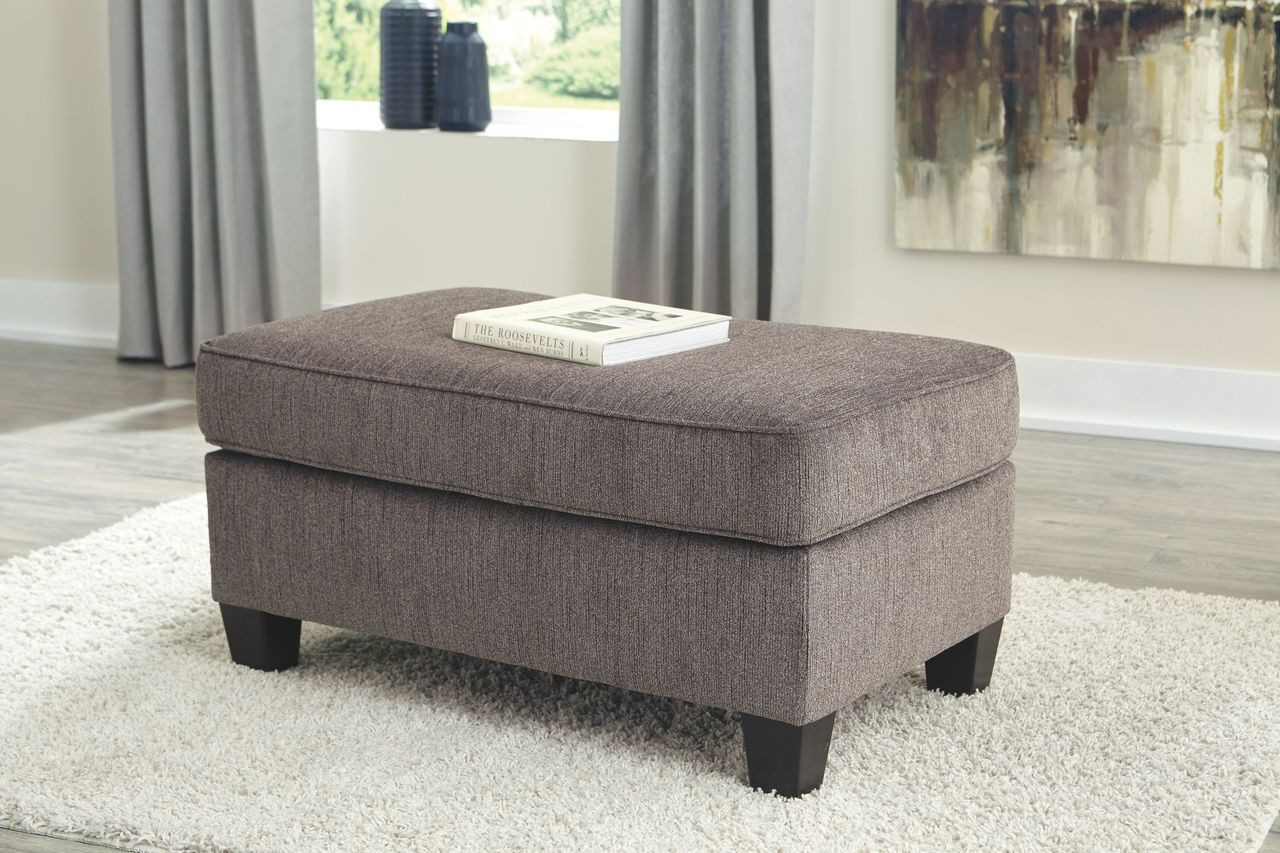 The Nemoli Slate Ottoman Available At Sweet Home Furniture