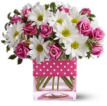 Polka dots and posies, they're the perfect pair. Well, at least in this pretty arrangement they are. Just the right flowers in just the right vase all wrapped up in, you guessed it, just the right ribbon