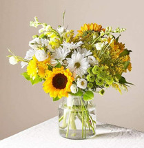 Give a dose of sunshine in bloom. This stunning bouquet is teeming with rays of sunflowers, textured snapdragons and darling daisy poms to deliver the perfect pick–me–up for an occasion or as a treat to yourself.  Please Note: The bouquet pictured reflects our original design for this product. While we always try to follow the color palette, we may replace stems to deliver the freshest bouquet possible, and we may sometimes need to use a different vase.