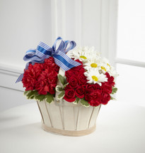 TheJustice Basket is a perfect display of patriotic beauty. Red spray roses, carnations and miniature carnations are accented with a spray of white standard daisies presented in a whitewash basket gorgeously accented with a blue designer ribbon to cr