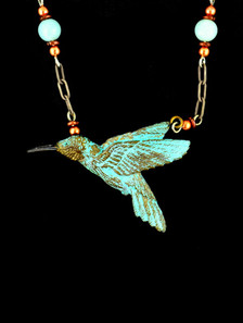 "Cavin Richie design hummingbird pendant, silicon bronze from original elk antler or woolly mammoth ivory carving, 1 3/4 "" X 1 1/4"", antiquated silver beaded chain included."