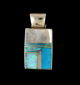 Sterling silver pendant in mother of pearl, denim lapis, and created opal. Authentic American Indian jewelry handcrafted by Navajo artists. Chain not included.