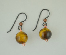 Each pair of tiger eye balls consists of genuine tiger eye stones on French wires, accompanied by our delightfully tacky packaging.